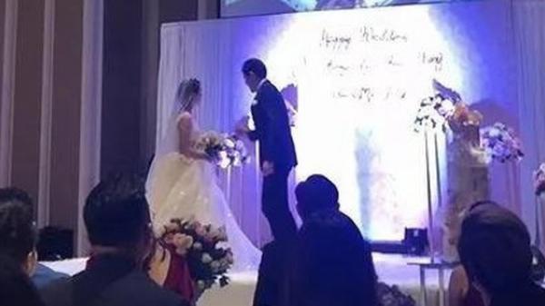 Biết cô dâu ngoại tình với anh rể mình, chú rể vẫn tổ chức đám cưới rồi chiếu luôn video của cặp đôi ngay hôn lễ