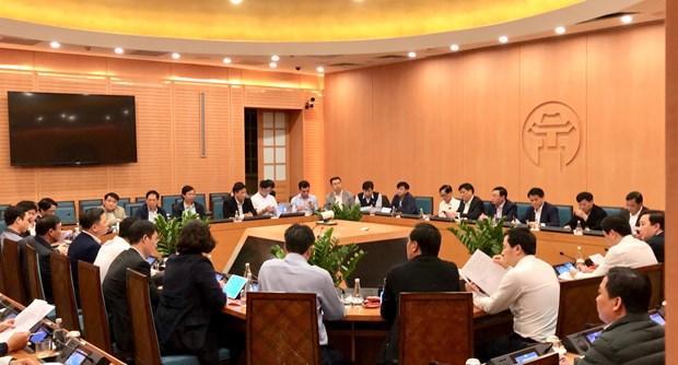 Quang cảnh cuộc họp khẩn của UBND TP Hà Nội, tối 6/3. (Nguồn: TTXVN).